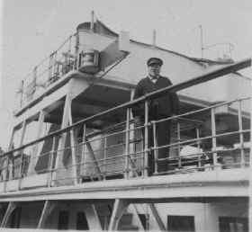 Captain Sharp on the liner tender