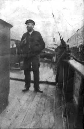 Captain Sharp on the deck of his tug